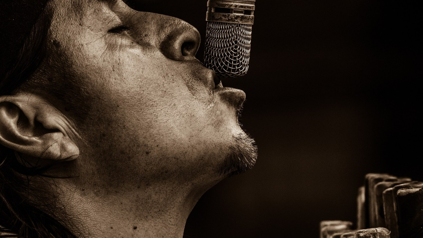 Man singing into a microphone.