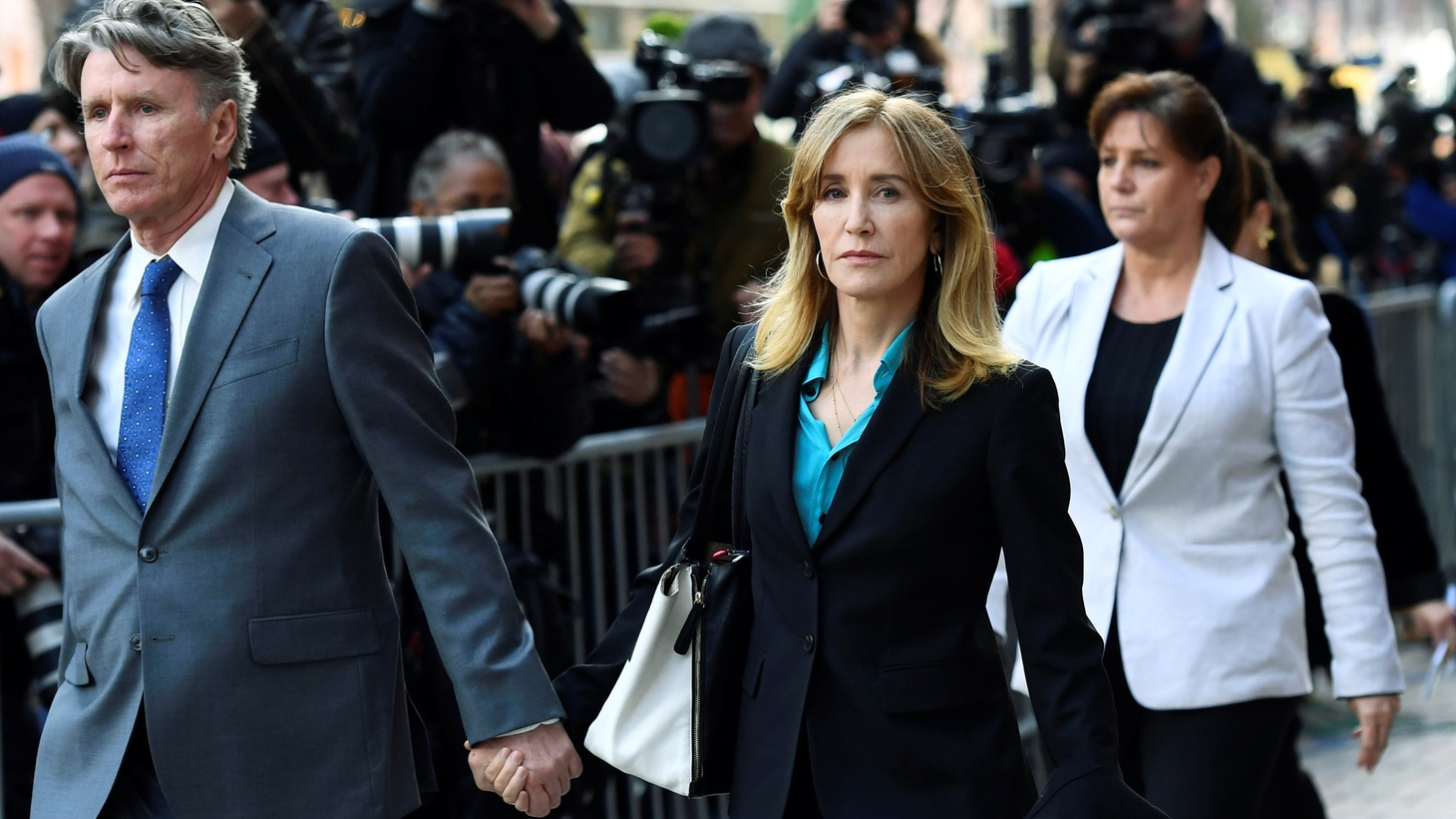Actor Felicity Huffman leaves the federal courthouse after facing charges in a nationwide college admissions cheating scheme in Boston, Massachusetts, U.S., April 3, 2019.