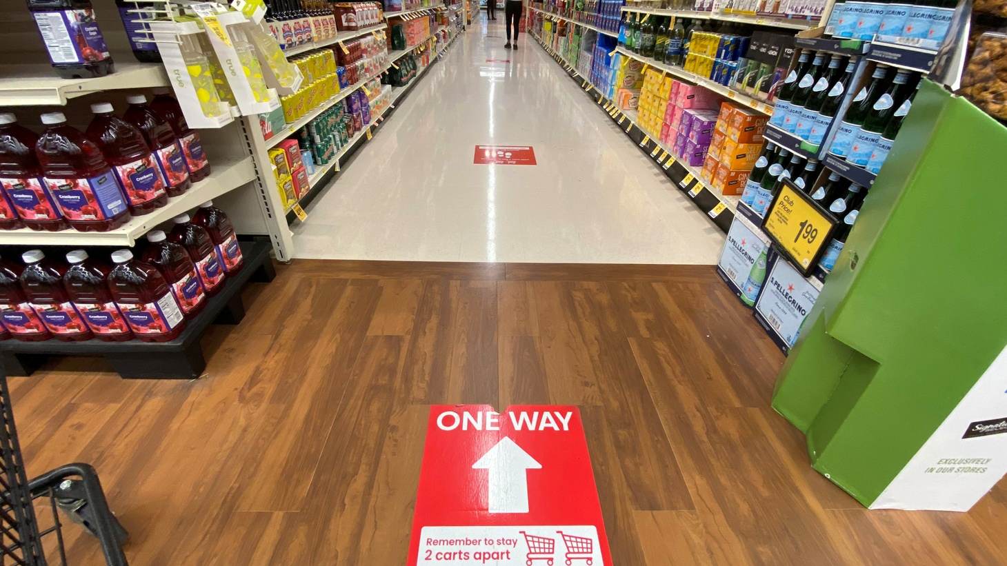 A direction sign on the floor at a Vons grocery store is pictured during the outbreak of the coronavirus disease (COVID-19), in Pasadena, California, U.S., June 10, 2020. Pasadena resident Vania Harris says she's had to rethink her grocery budget after the $600/week unemployment benefits ran out. She lost her job as a bartender when the pandemic hit.