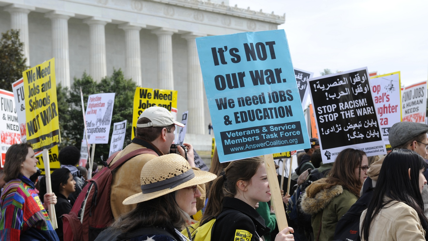 Carrying signs, protesters head to the Pentagon as part of an anti-war march and rally in Washington, D.C., March 21, 2009.