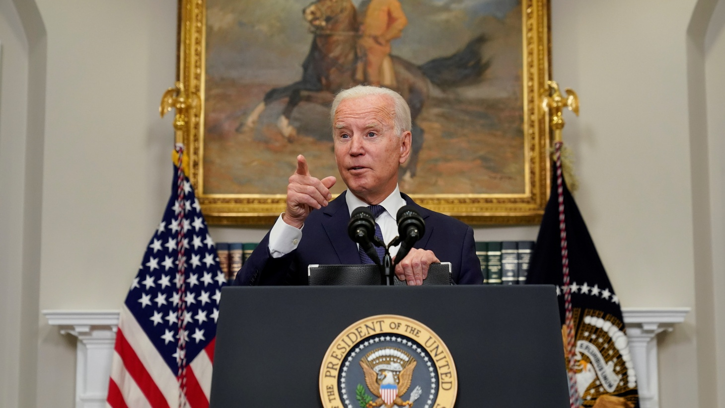 U.S. President Joe Biden gestures as he answers questions about Hurricane Henri and the evacuation of Afghanistan during a news conference in the Roosevelt Room of the White House in Washington, D.C., U.S. August 22, 2021.