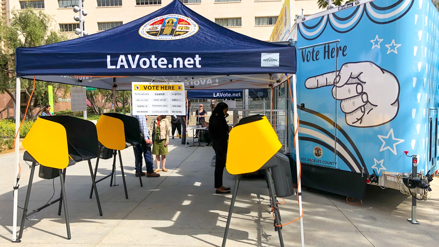 A voter uses one of L.A. County's new touchscreen ballot marking devices.