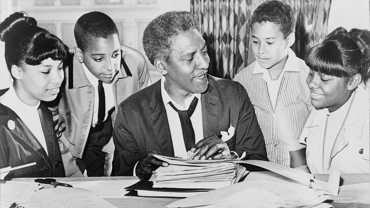 Bayard Rustin, a member of the LGBTQ community, was posthumously pardoned by Governor Newsom two weeks ago. In 1953, he was arrested in Pasadena for having sex in a parked car.