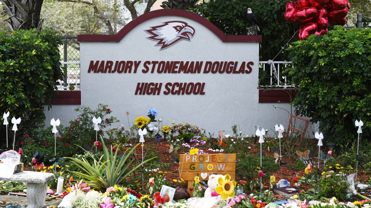 A memorial is set up at Marjory Stoneman Douglas High School in Parkland, Florida, February 14, 2021. It marks the three-year anniversary of the mass shooting that broke out there on February 14, 2018. Three staff members and 14 students were killed in the shooting.