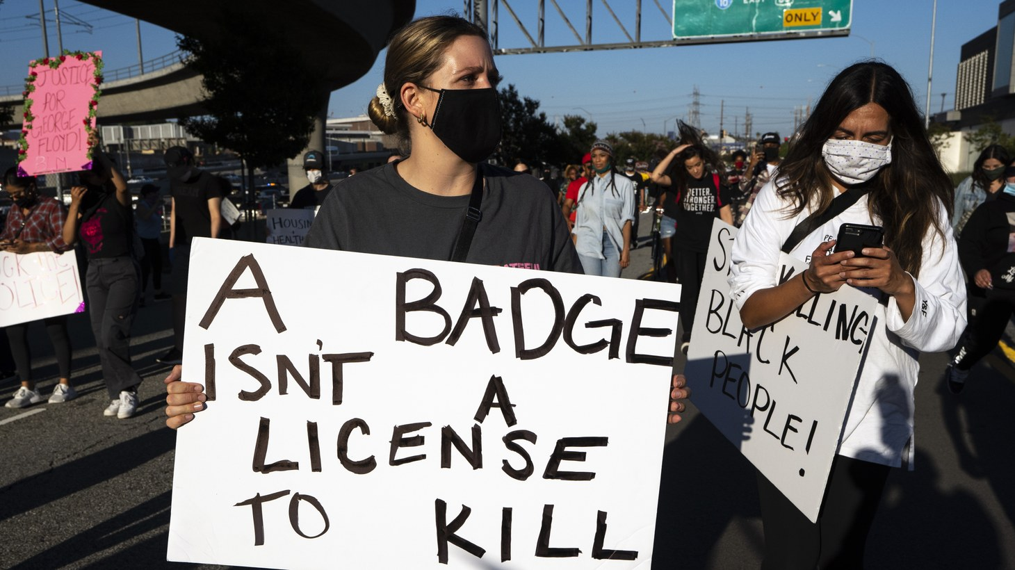 Demonstrators participate in an anti-police brutality protest following the killing of George Floyd in Minnesota by a white police officer. Los Angeles, California on May 27, 2020.