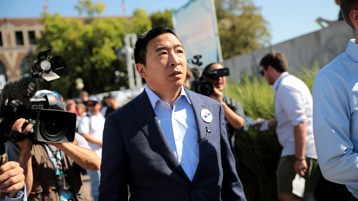Andrew Yang speaking with supporters at the Des Moines Register's Political Soapbox at the 2019 Iowa State Fair in Des Moines, Iowa.