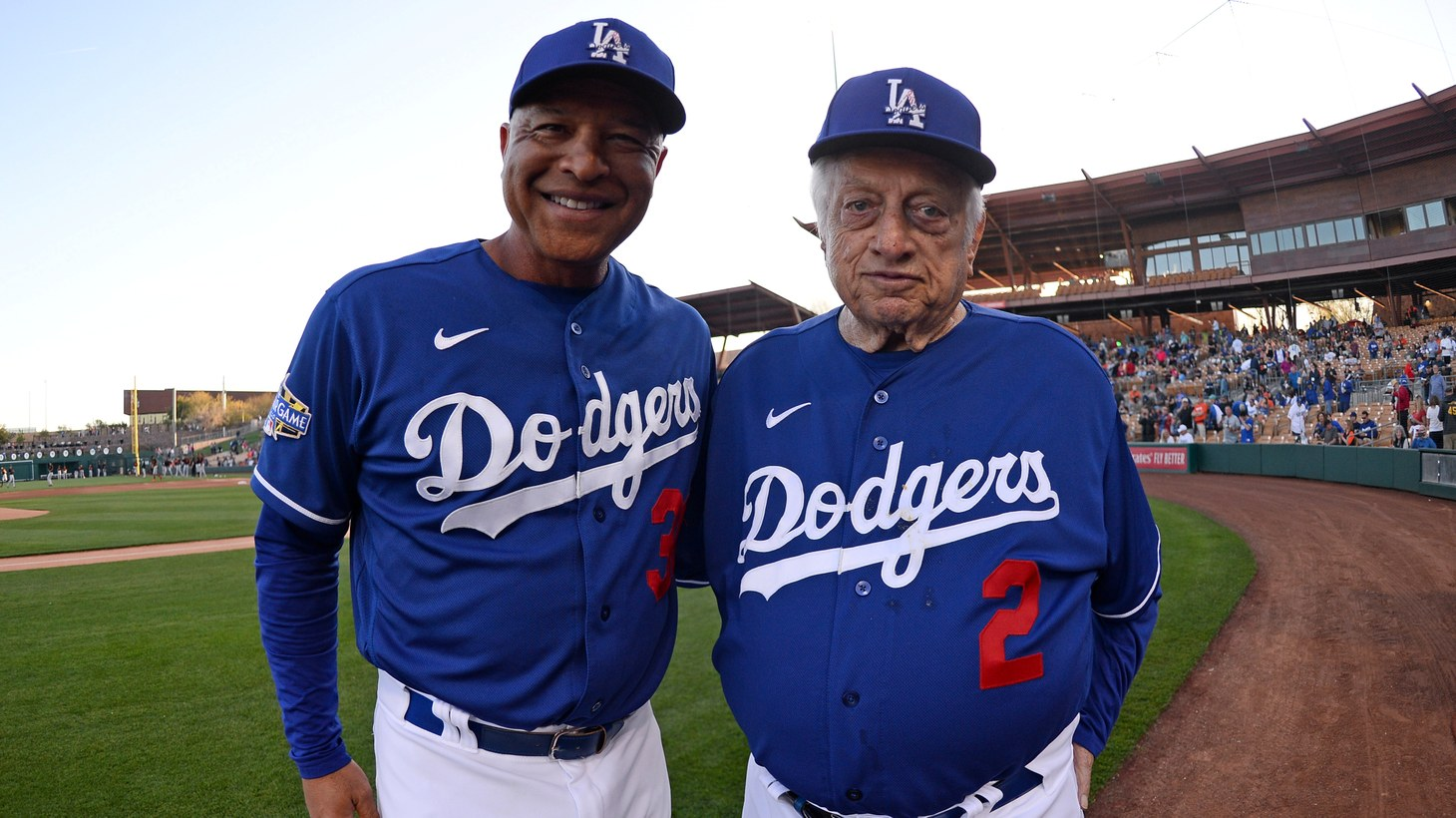 Los Angeles Dodgers former manager Tommy Lasorda (2) poses for a photo alongside current Dodgers manager Dave Roberts (30) prior to a spring training game against the San Francisco Giants at Camelback Ranch. Mar 4, 2020. Phoenix, Arizona, USA.