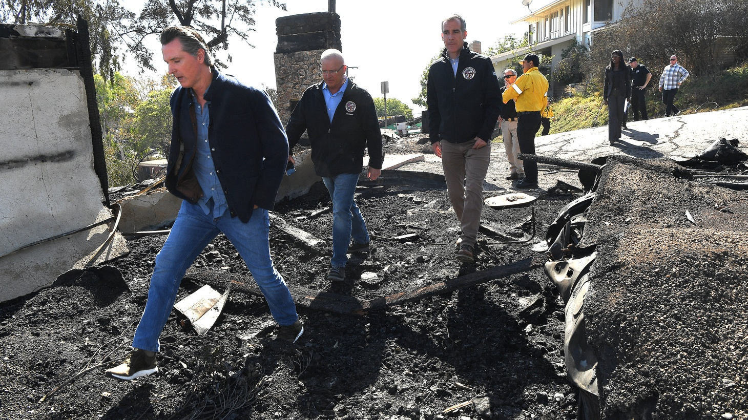 California Governor Gavin Newsom, L.A. City Councilman Mike Bonin and L.A. Mayor Eric Garcetti, view a burned home along Tigertail Road in Brentwood, California October 29, 2019.