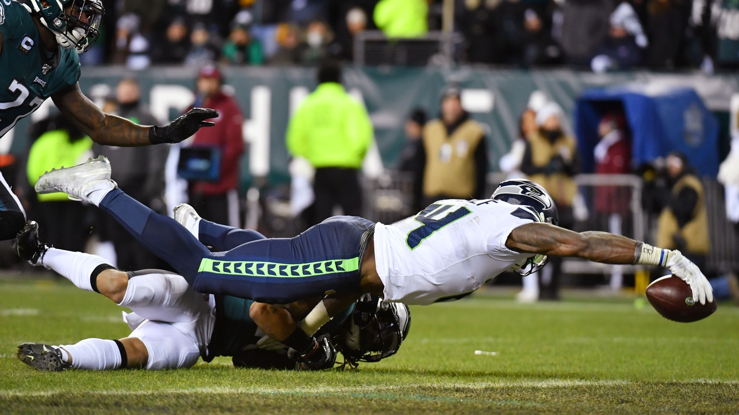 Jan 5, 2020; Philadelphia, Pennsylvania, USA; Seattle Seahawks wide receiver D.K. Metcalf (14) reaches for the endzone to score a touchdown as Philadelphia Eagles cornerback Avonte Maddox (29) attempts to make the tackle during the third quarter in a NFC Wild Card playoff football game at Lincoln Financial Field.
