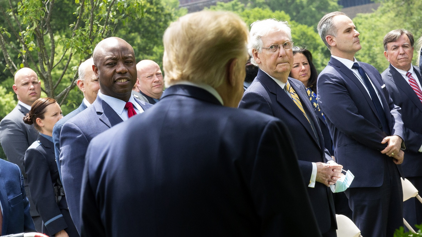 U.S. Sen. Tim Scott (R-SC), left, and Senate Majority Leader Mitch McConnell (R-KY) look on as President Trump arrives to the Rose Garden to sign an Executive Order on Safe Policing for Safe Communities at the White House in Washington D.C. on Tuesday, June 16, 2020.