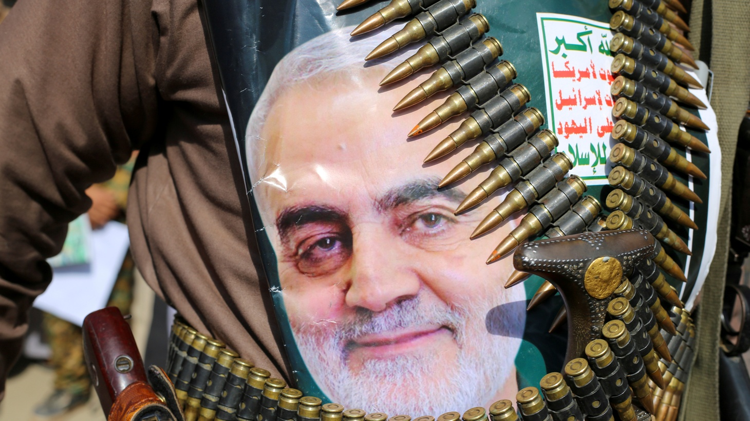 A supporter of the Houthis has a poster attached to his waist of Iranian Major-General Qassem Soleimani, who was killed in an air strike at Baghdad airport, during a rally to denounce the U.S. killing, in Saada, Yemen January 6, 2020.