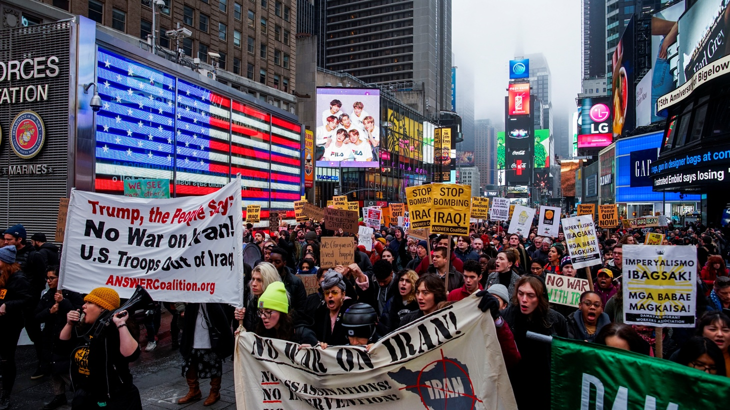 People marching in an anti-war protest amid increased tensions between the U.S. and Iran at Times Square in New York, U.S., January 4, 2020.