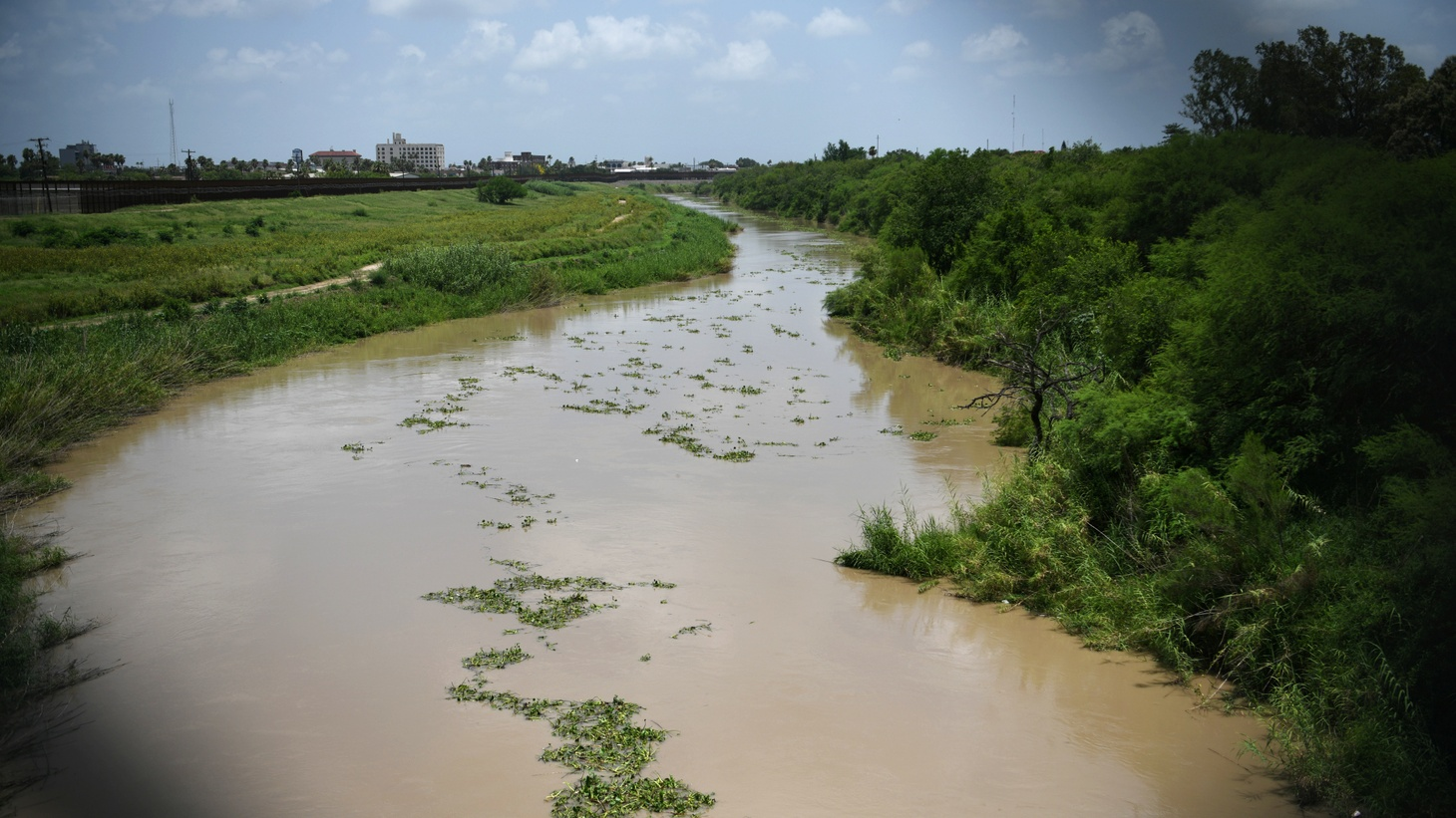 The Rio Grande, near the location where the bodies of Salvadoran migrant Oscar Alberto Martinez Ramirez and his 23-month old daughter Valeria were found after they drowned, is pictured from the Mexican side of the Brownsville-Matamoros International Bridge at the U.S.-Mexico border in Matamoros, Tamaulipas, Mexico, June 26, 2019. Picture taken through a fence.