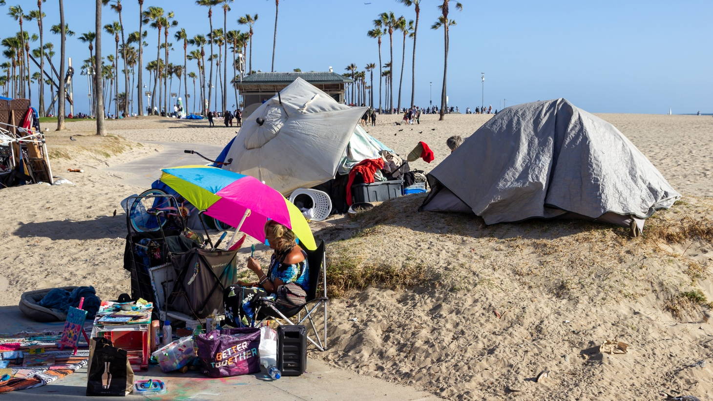 Unhoused people have tents set up along the Venice Beach Boardwalk, May 22, 2021.
