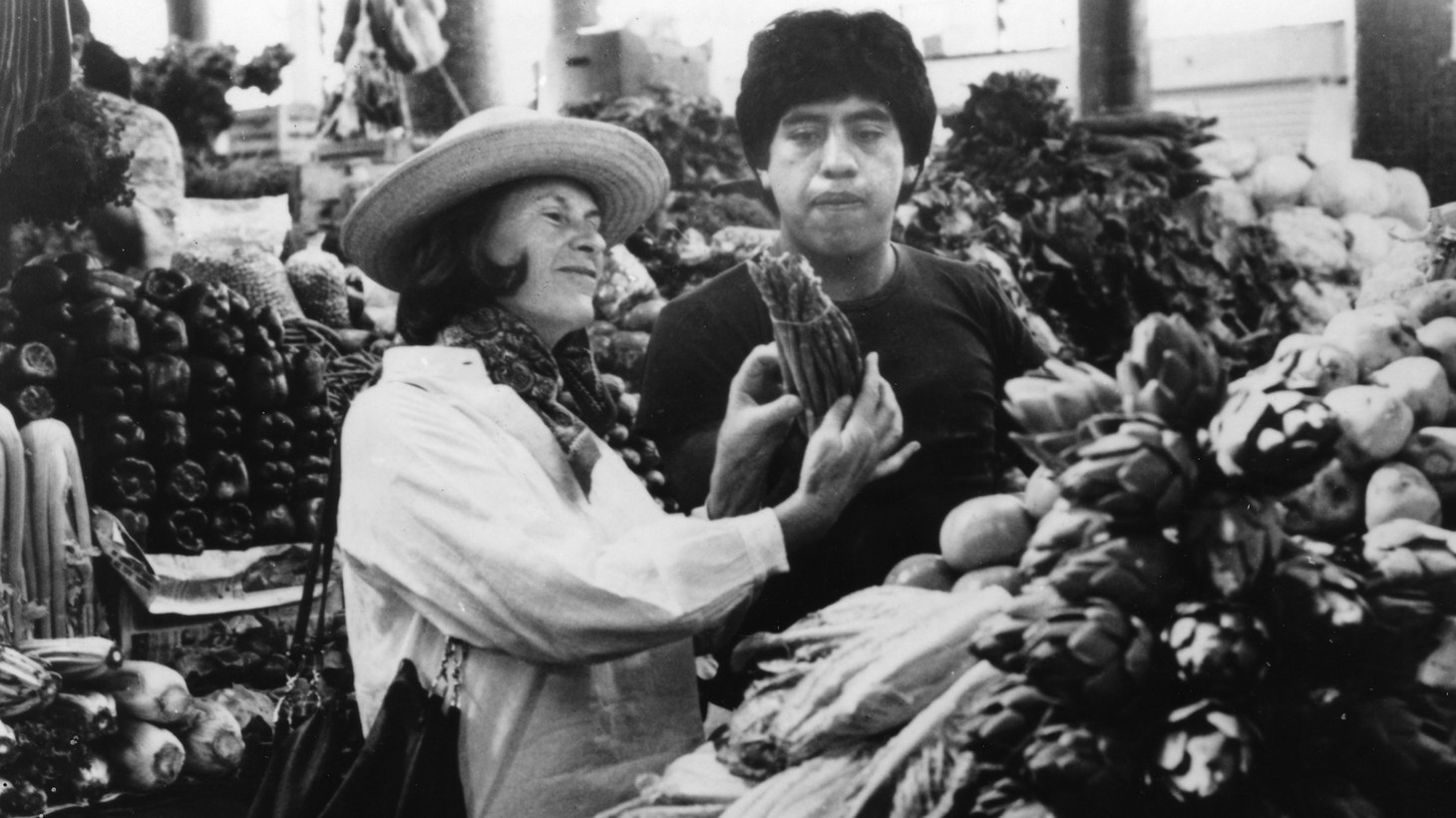 Diana Kennedy admires asparagus in a Mexico City market in the 1960s.
