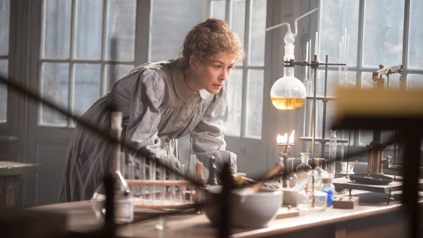 "Rosamund Pike stars as Marie Curie in ""Radioactive."""