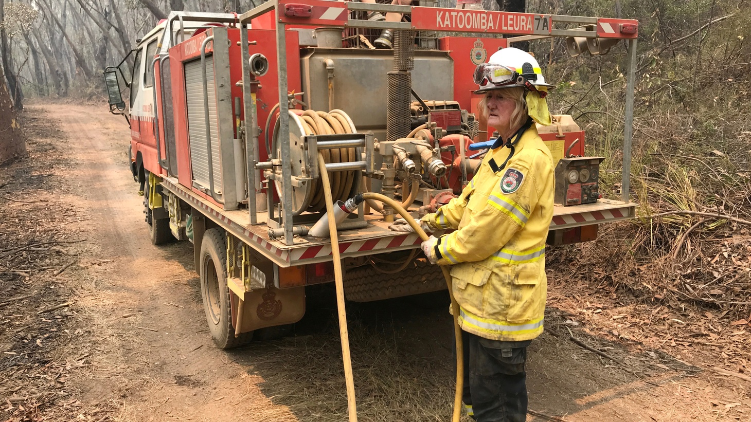 A volunteer from the New South Wales Rural Fire Service works to extinguish spot fires following back burning operations in Mount Hay, in Australia's Blue Mountains, December 28, 2019.