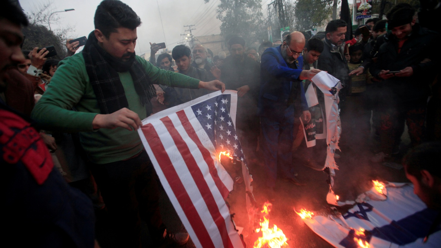 Pakistani Shi'ite Muslim supporters of Majlis-e-Wahdat-e-Muslimeen (MWM) burn U.S and Israel's flags to condemn the death of Iranian Major-General Qassem Soleimani, who was killed in an airstrike near Baghdad, during a protest in Lahore, Pakistan January 3, 2020.