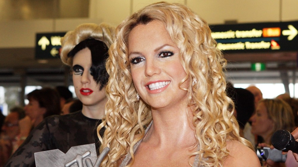 Britney Spears holding a music award at Sydney International Airport, February 2013.