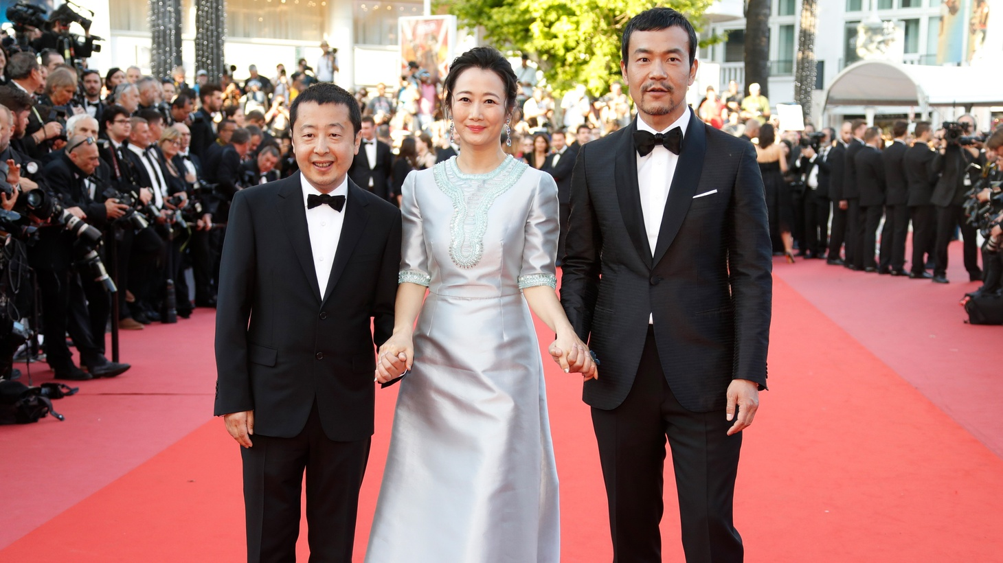 "Director Jia Zhangke and cast members Zhao Tao and Fan Liao pose as they arrive for the screening of ""Ash Is Purest White"" at the 71st Cannes Film Festival, in Cannes, France, May 11, 2018."