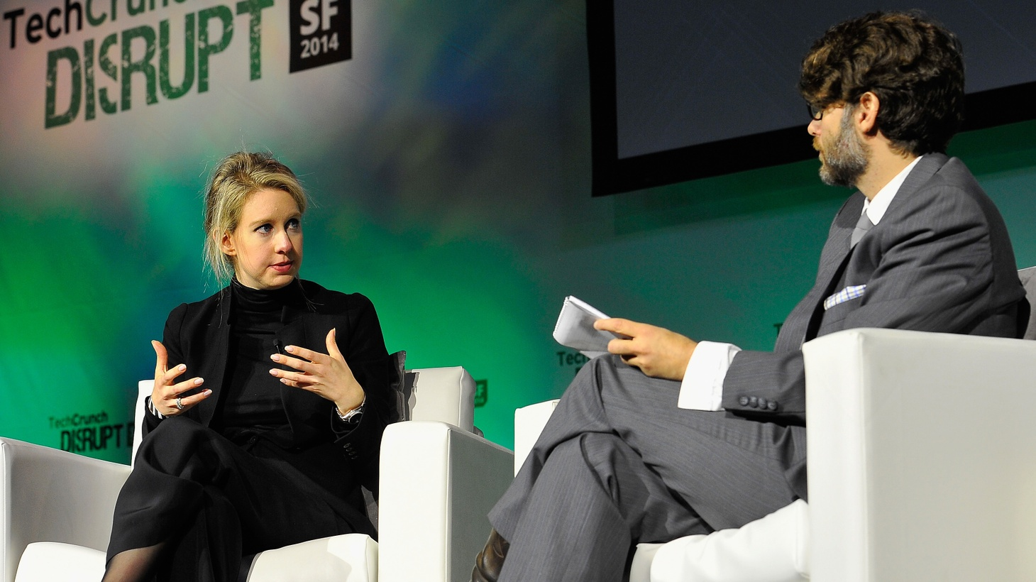 Theranos Founder Elizabeth Holmes (L) and TechCrunch Writer and Moderator Jonathan Shieber speak onstage at TechCrunch Disrupt on September 8, 2014 in San Francisco, California.