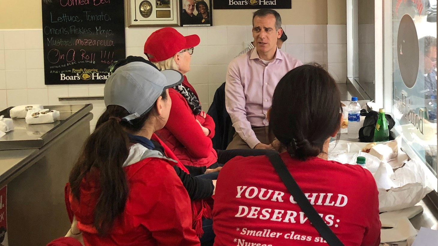 Los Angeles Mayor Eric Garcetti sits at a deli counter and talks with striking teachers in downtown Los Angeles, California, U.S., January 15, 2019.