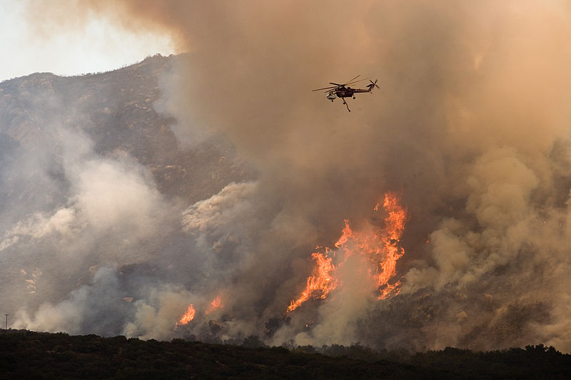 Helicopters drop water and fire retardant on the Harris fire, near the Mexican border, to stop the wildfire from advancing. Currently the fires in Southern California have burned nearly 350,000 acres