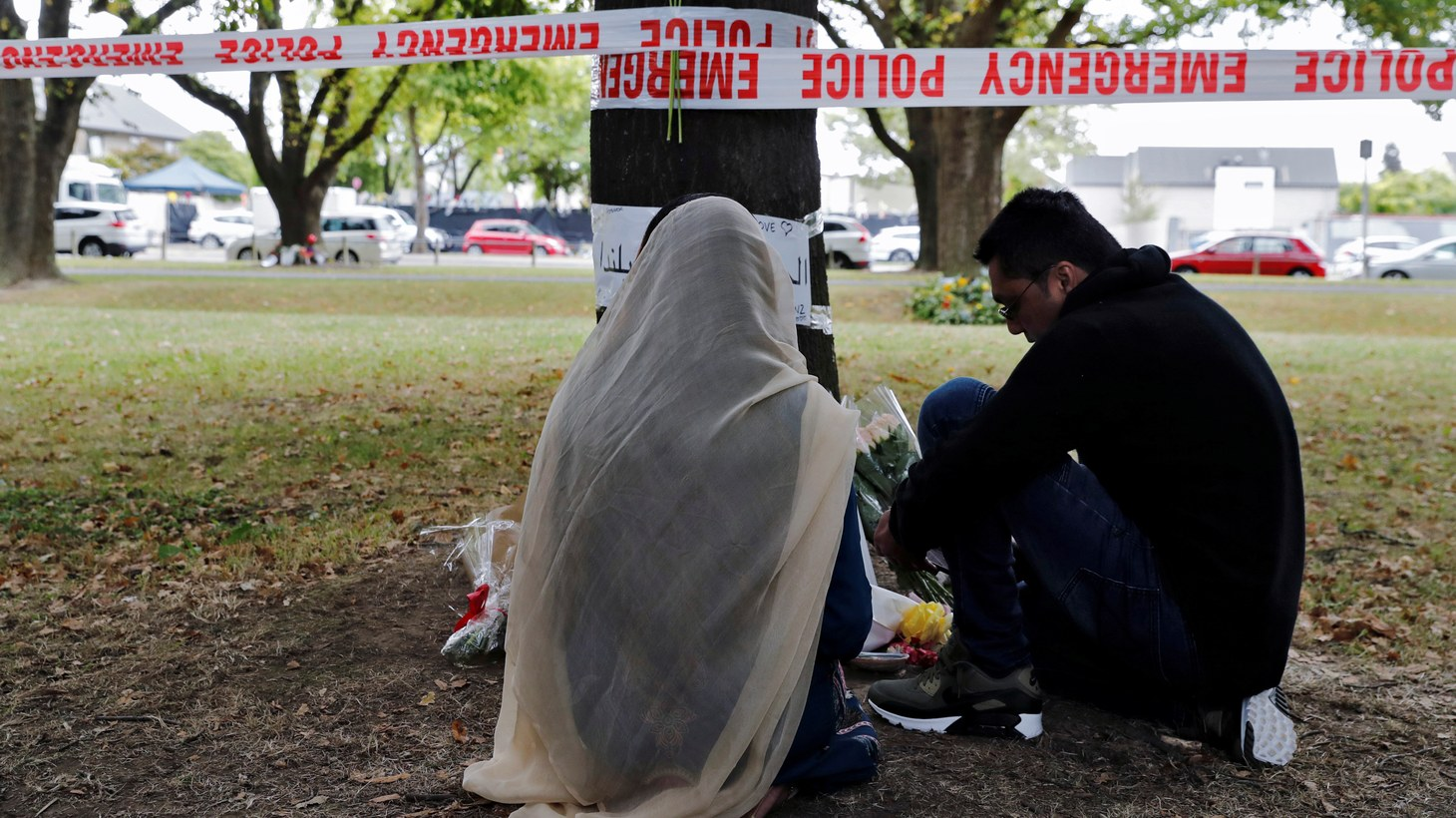 People visit at a memorial site for victims of the March 15 shooting, in front of the Masjid Al Noor mosque in Christchurch, New Zealand March 18th, 2019.