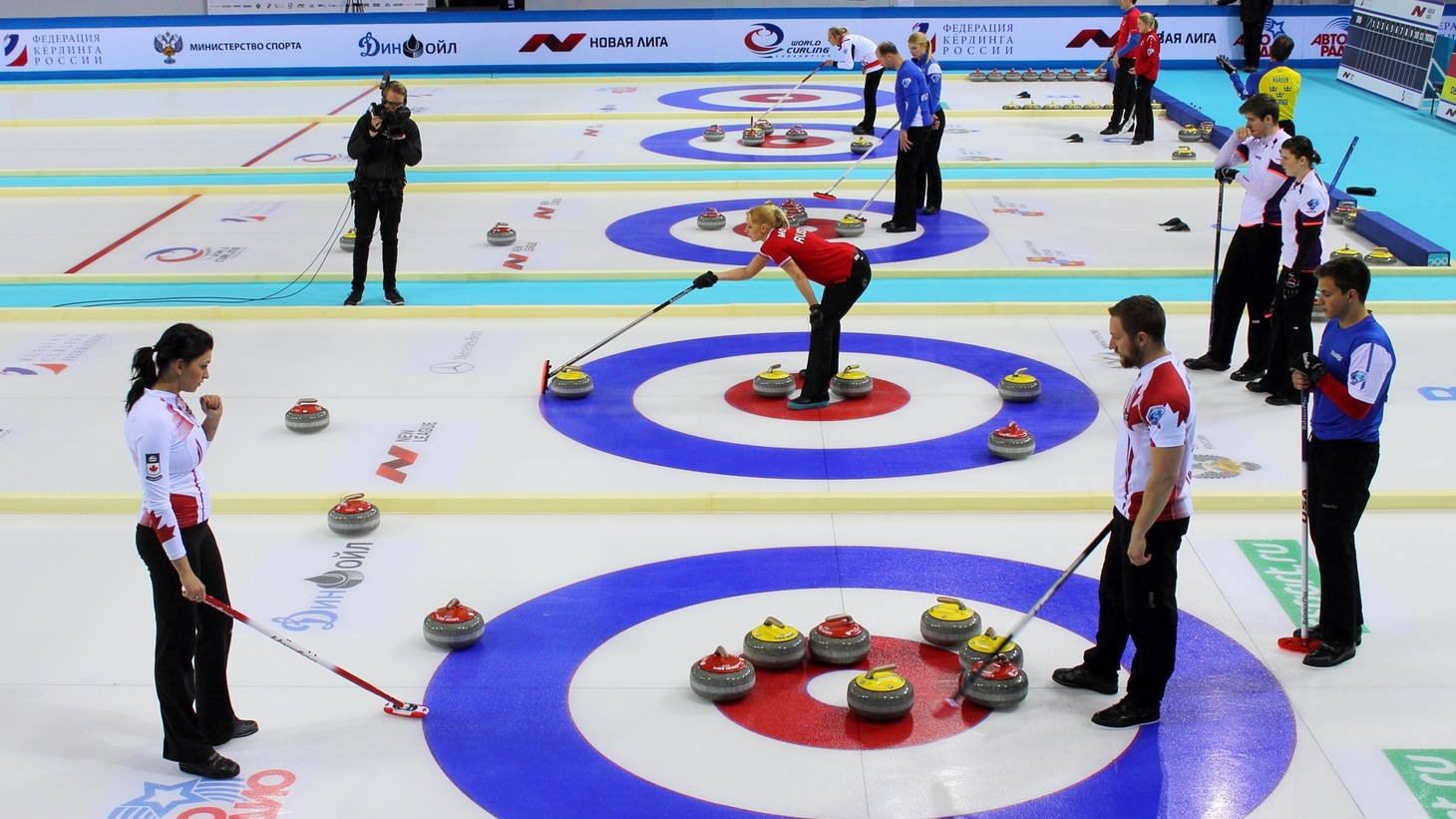 """Last night at the Latin Grammys, Mexican rockers unfurled a banner that said in Spanish """"Latinos united, don't vote for racists."""" And curlers everywhere are up in arms over their brooms. Curling the sport, that is."""