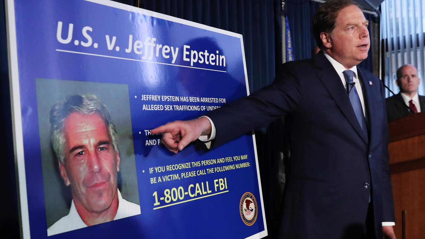 Geoffrey Berman, United States Attorney for the Southern District of New York, points to a photograph of Jeffrey Epstein as he announces the financier's charges of sex trafficking of minors and conspiracy to commit sex trafficking of minors, in New York, U.S., July 8, 2019.