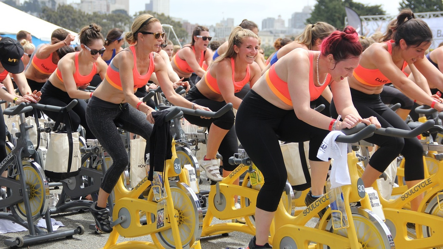 Women on SoulCycle indoor bikes.