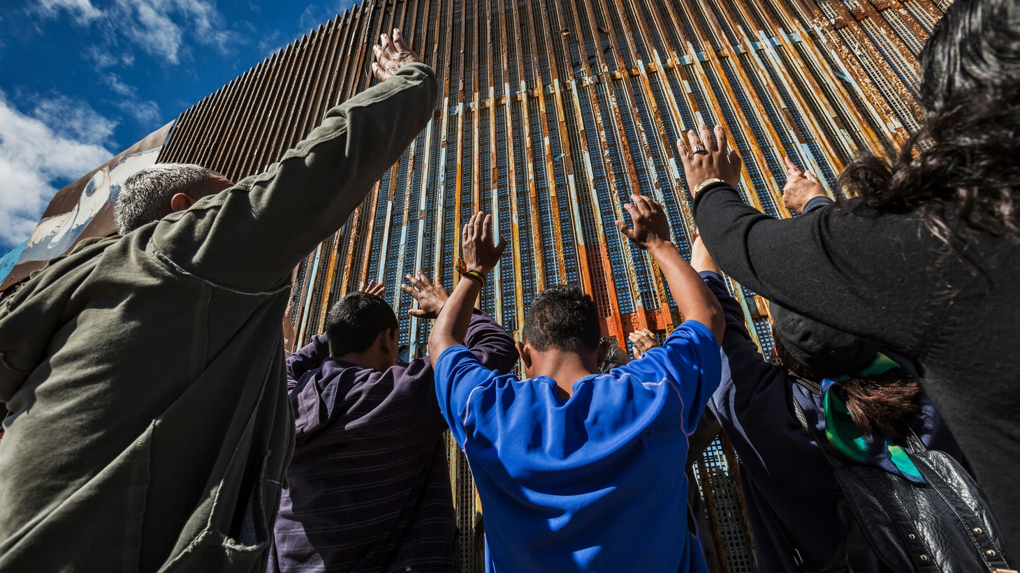 A prayer service at the border fence in Tijuana. Many of the participants took communion then attempted to cross the border. March 5, 2017, US/Mexico border, Tijuana, Mexico.