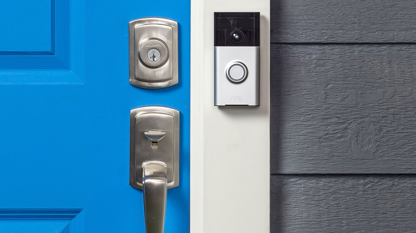 A Ring video doorbell is mounted next to the front door of a house. Even though the footage can help law enforcement, it also poses risks.