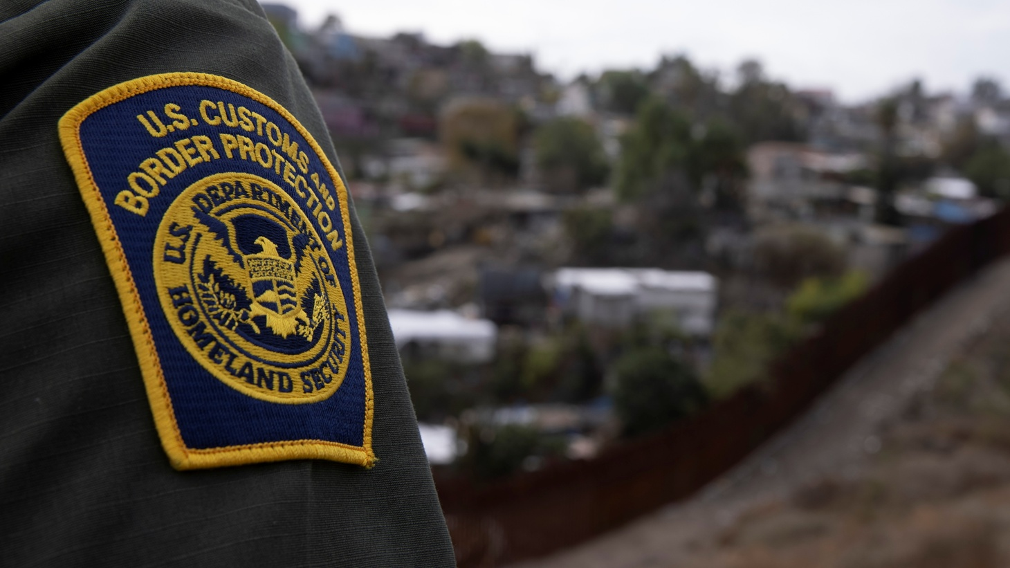 A U.S. border patrol agent looks out over Tijuana, Mexico from the U.S.-Mexico border wall in San Diego, California, U.S., February 2, 2021.