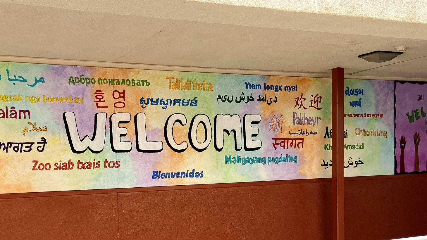 A sign — in multiple languages — welcomes students to Elk Grove Unified School District.