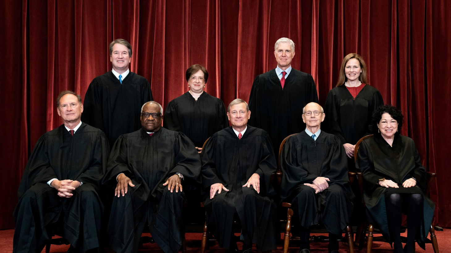Justices Brett Kavanaugh, Elena Kagan, Neil Gorsuch, Amy Coney Barrett, Samuel Alito, Clarence Thomas, John Roberts, Stephen Breyer and Sonia Sotomayor pose for a group photo at the Supreme Court in Washington, U.S., April 23, 2021.