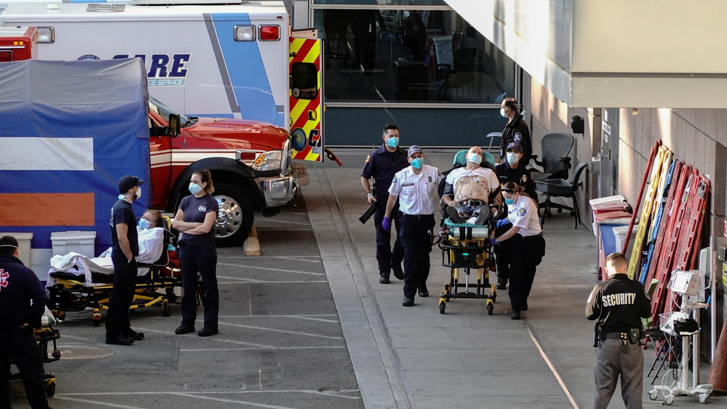 Paramedics escort a patient from the ambulance entrance to the emergency room at LAC + USC Medical Center during a surge of coronavirus disease (COVID-19) cases in Los Angeles, California, U.S., December 27, 2020.