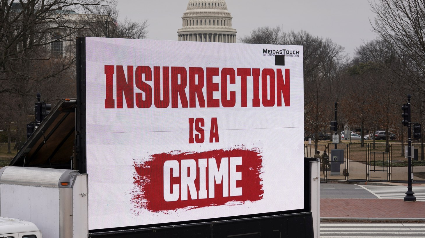A video screen affixed to a truck flashes an anti-Trump message near the U.S. Capitol during former U.S President Donald Trump's second impeachment trial in Washington, U.S., February 12, 2021.