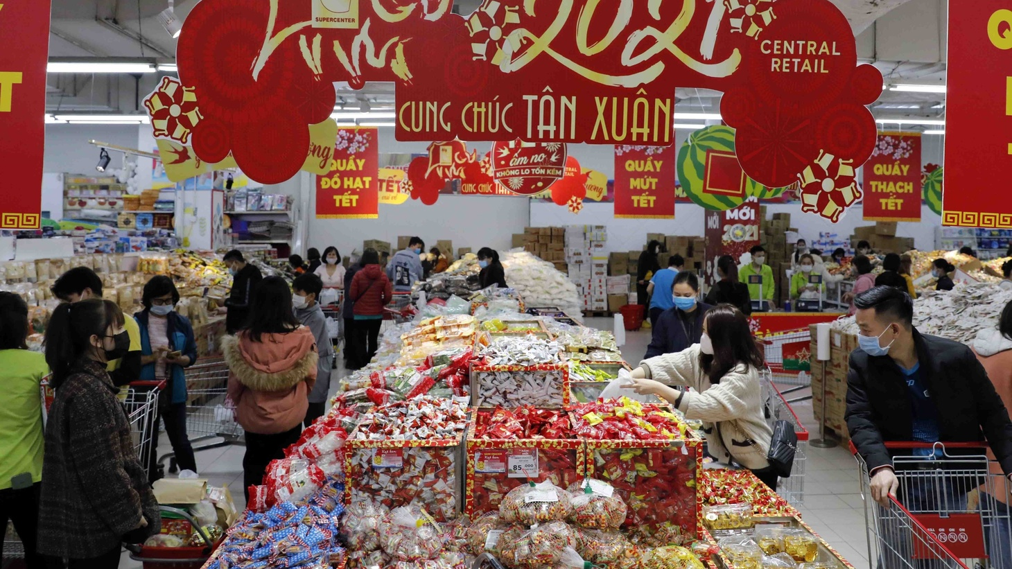 Vietnamese people stock up on food in a supermarket in Hanoi, Vietnam, February 5, 2021. Businesses in the city have made great efforts to increase production to meet the growing demand during Tet and have strictly followed preventive measures for COVID-19.