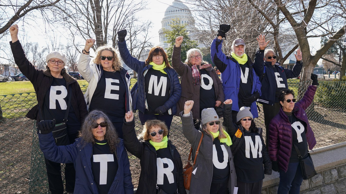 Demonstrators wave to passing motorists at the U.S. Capitol on the second day of the Senate impeachment trial of U.S. President Donald Trump in Washington U.S., January 22, 2020.