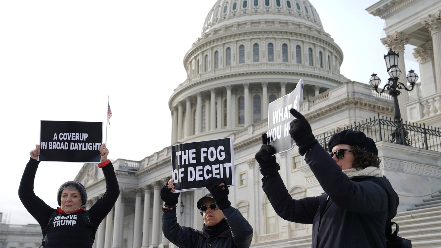 People demonstrate outside of the U.S. Capitol on the third day of the Senate impeachment trial of U.S. President Donald Trump in Washington, U.S., January 23, 2020.