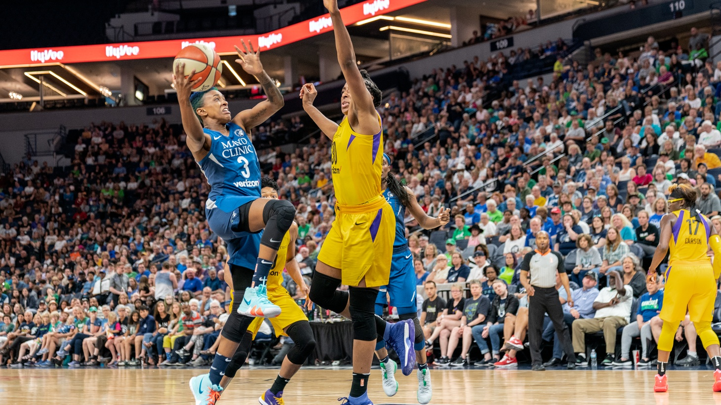 Danielle Robinson drives to the basket as Nneka Ogwumike guards her in the Minnesota Lynx vs Los Angeles Sparks game at Target Center, 2018.
