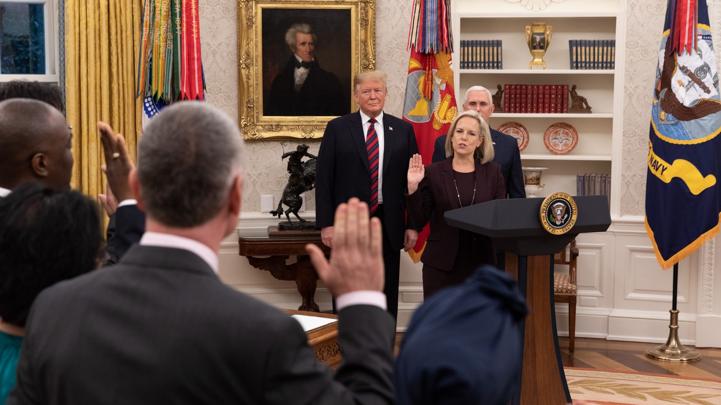 President Donald J. Trump, joined by Vice President Mike Pence, watches as Department of Homeland Security Secretary Kirstjen Nielsen swears in naturalization candidates on January 19, 2019, in the Oval Office.