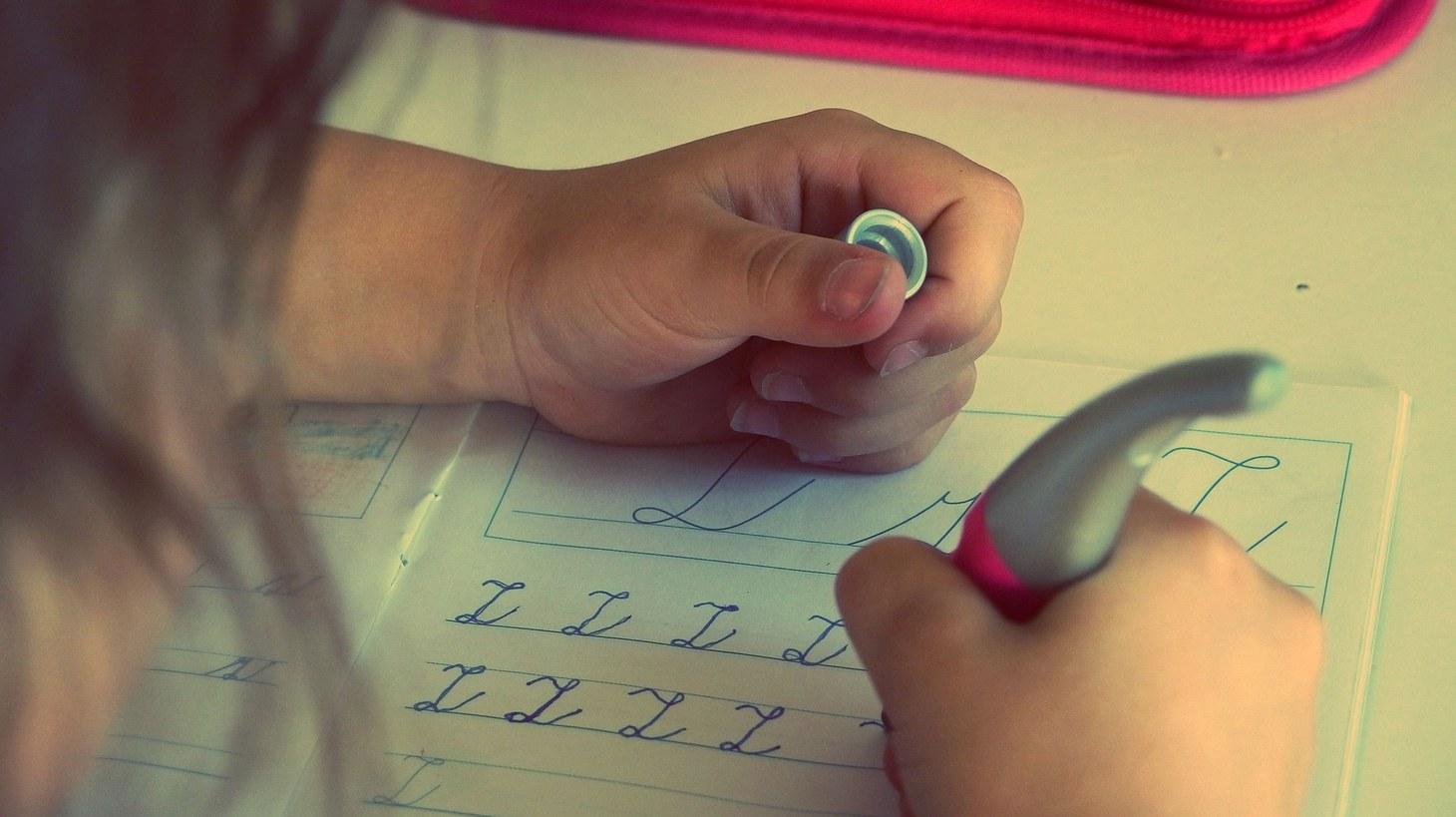 A child writing letters.