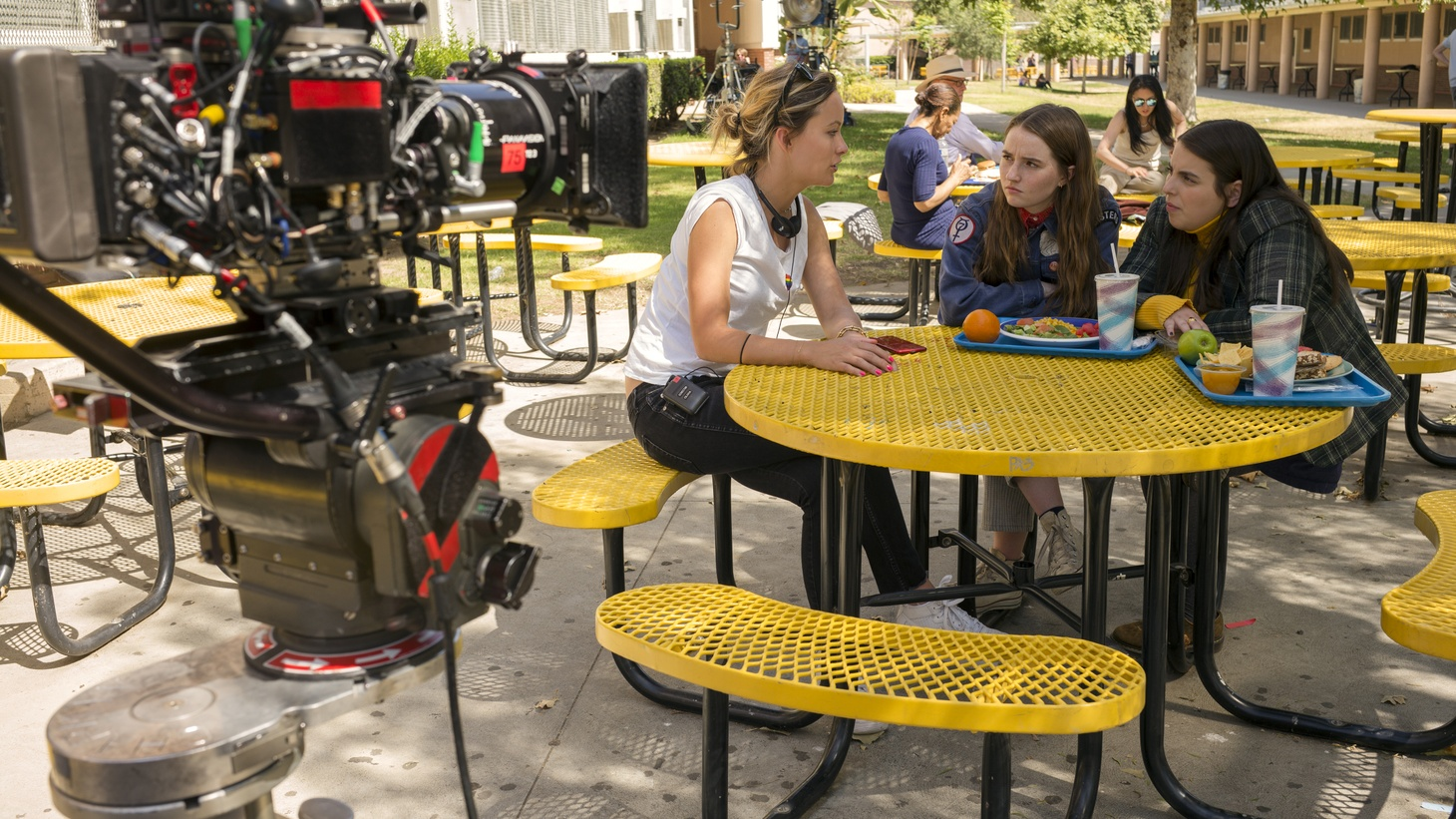 "Director Olivia Wilde and actors Kaitlyn Dever and Beanie Feldstein on the set of ""Booksmart."""