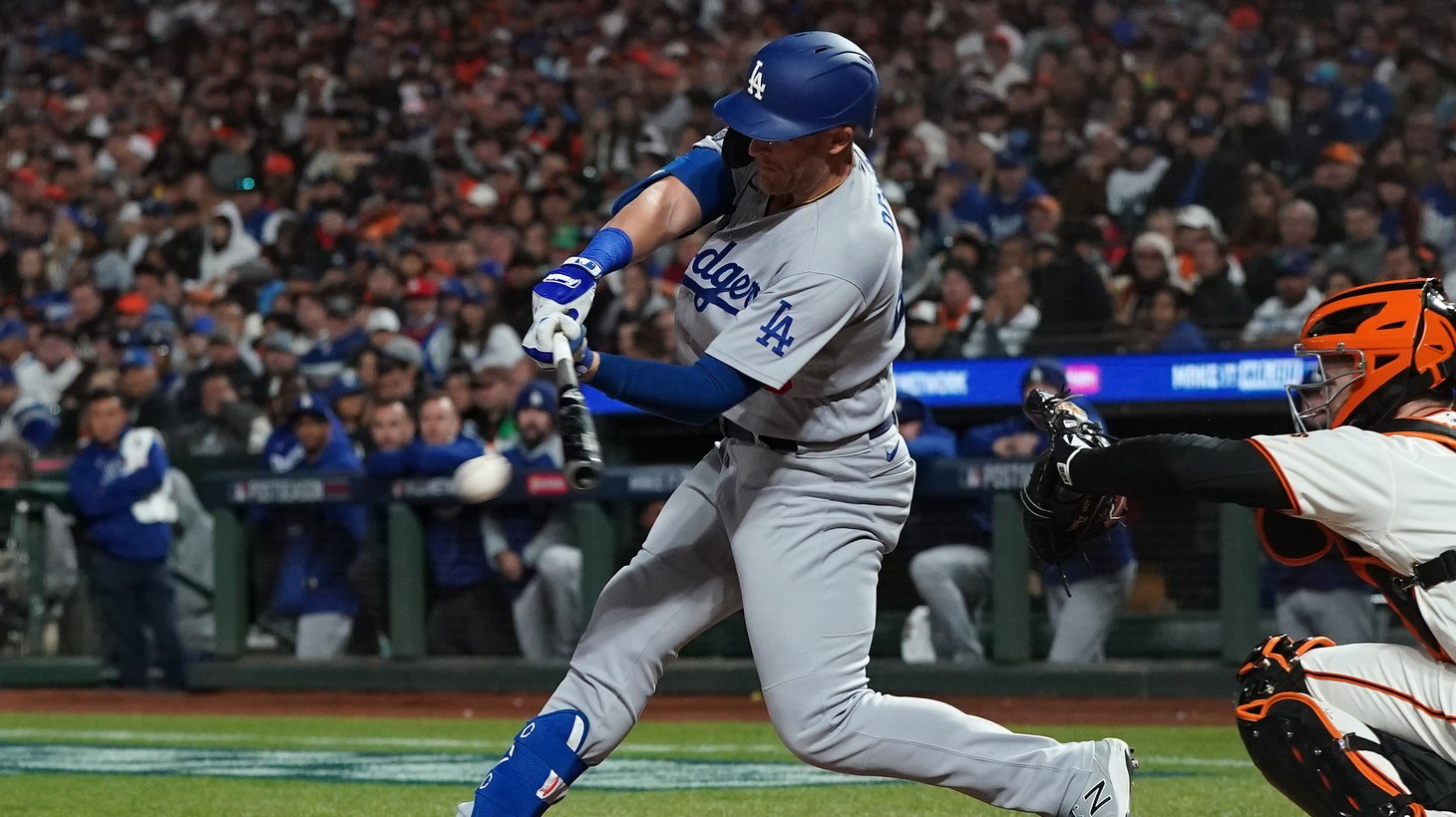 Los Angeles Dodgers pinch hitter Matt Beaty (45) drives in a run with a single against the San Francisco Giants in the eighth inning during game two of the 2021 NLDS at Oracle Park, San Francisco, California, Oct 9, 2021.