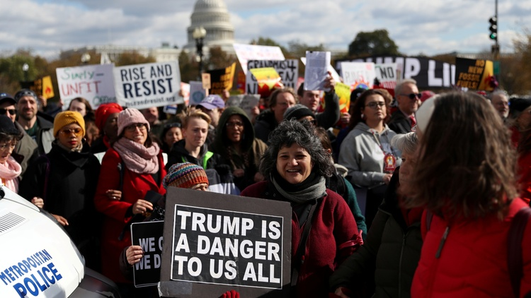 """Dozens of demonstrators chanting """"home is here"""" arrived in Washington DC on Sunday after a 230-mile march that began last month in New York."""