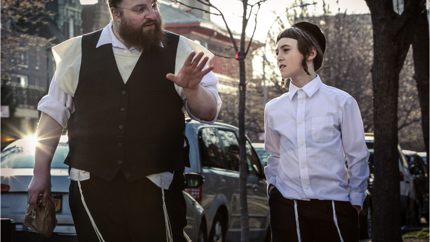 """""""Menashe"""" is a new movie about life inside New York's hasidic community. The director talks about shooting a movie on location where you're not wanted, with actors who've never been in a movie or seen a movie before.      Menashe Lustig and Ruben Niborski in """"Menashe."""" (Photo by Federica Valabrega, courtesy of A24)"""