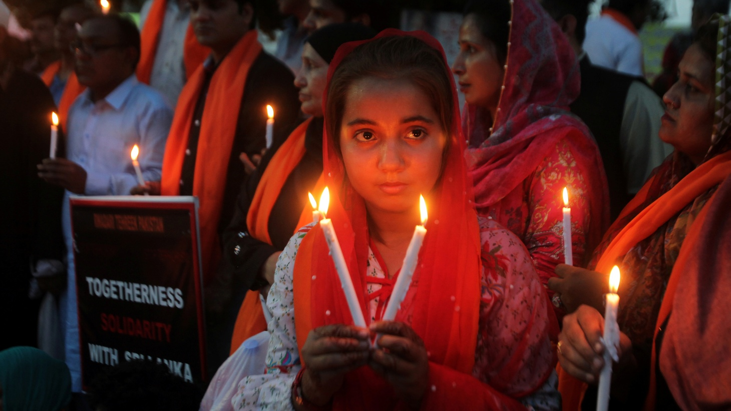 A girl holds candles with others for the victims of Sri Lanka's serial bomb blasts, in Lahore, Pakistan April 23, 2019.