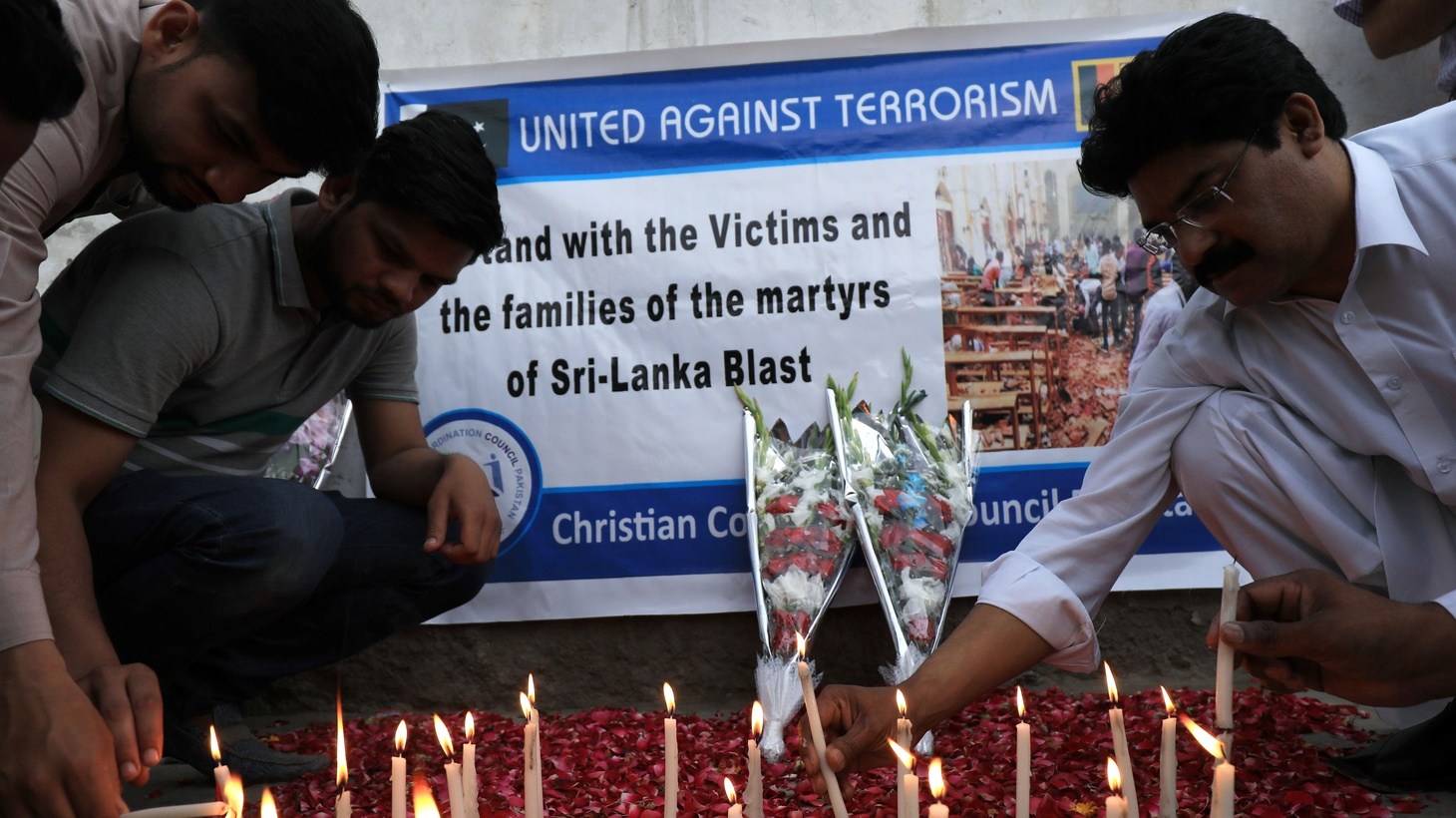 People light candles for the victims of Sri Lanka's serial bomb blasts, in Peshawar, Pakistan April 23, 2019.
